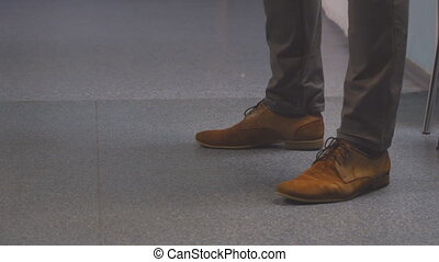 Feet men in brown shoes - Feet nervous men in brown shoes