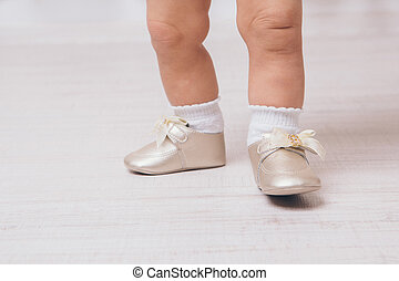 feet of a baby in pointe shoes, close-up
