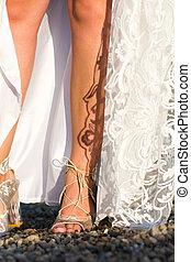 Feet of a bride in wedding dress