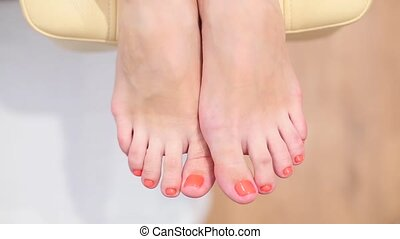 Feet of a girl after a pedicure
