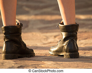 Feet of a girl in shoes on the road