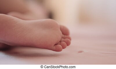 Feet of a sleeping child. Close-up.