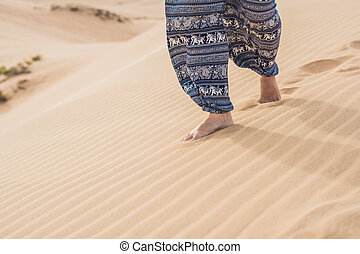 Feet of a woman in the desert