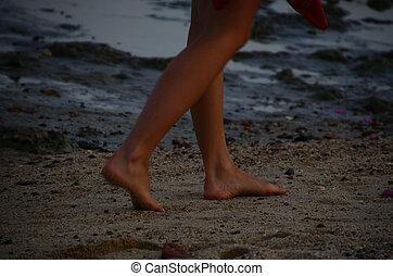 feet of a woman on sand