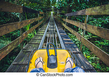 Feet of a young woman on Alpine Coaster