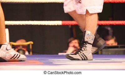 Feet of boxers during boxing match - MOSCOW - JAN 08: Feet...