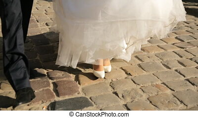 Feet Of Bride And Groomshot in slow motion couple walking close up