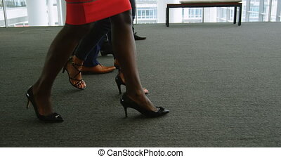 Feet of business people walking in the office 4k