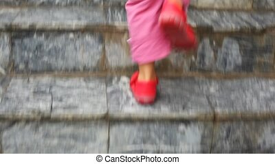feet of child walking up on ladder steps, camera follow...