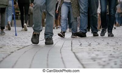 Feet of Crowd People Walking on the Street in Slow Motion -...