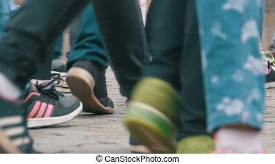 Feet of Crowd People Walking on the Street in Slow Motion