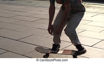 Feet of man skater making ollie trick from bank - Skillful...