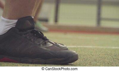 Feet of men lifting a dumbbells - Close up feet of men...