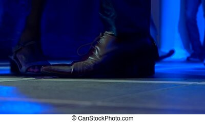 Feet of people dancing.