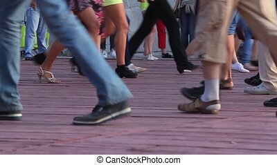 Feet of people dancing quadrille on a terrace