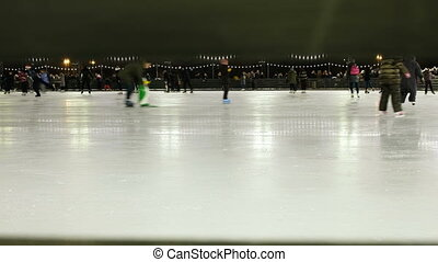 Feet of people ice-skating outdoors, 4K.