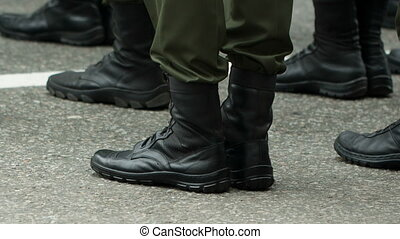 Feet of soldiers at army - soldiers feet standing on the...