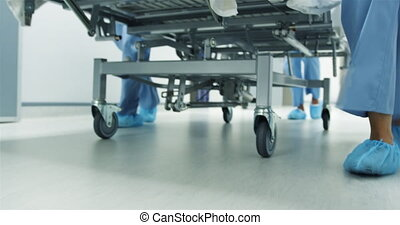 Feet of staff moving hospital bed in an emergency 4k