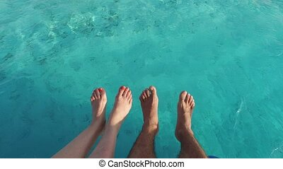 feet on deck of sailboat or yacht sailing in sea - vacation,...