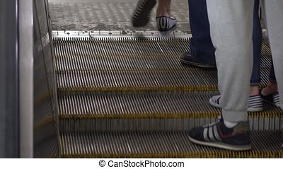Feet on moving staircase of Moscow metro 4K telephoto video...