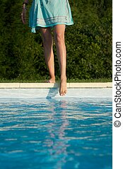 woman barefoot at swimming pool border in Asturias Spain