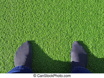 feet on synthetic or artificial grass