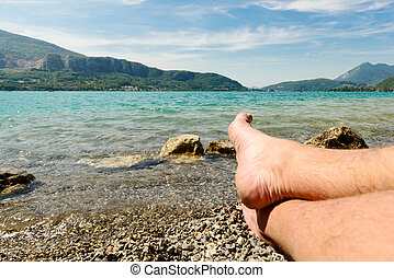 feet on the beach of lake of Annecy