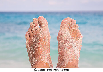 Feet on Tropical Beach