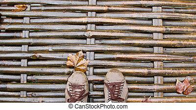 Feet on wooden bridge