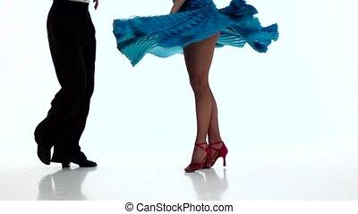 Feet pair ballroom dancers perform samba, white background....