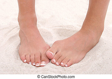 Shy Feet With Pedicure Standing in Sand. Shot in studio over white with the Canon 20D.