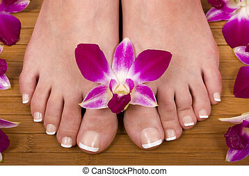 Feet - Spa treatment with fresh beautiful orchids