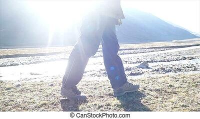 Feet river trekking mountains - Walking feet overcoming...