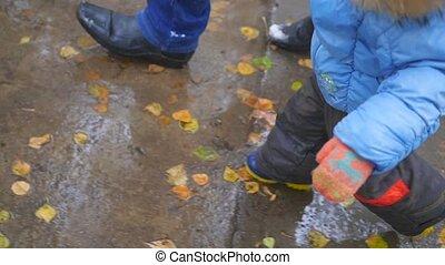 feet run on wet pavement at autumn time