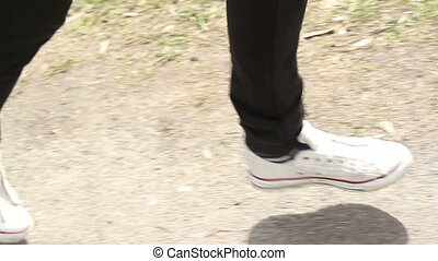feet running along the path