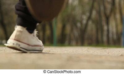 Feet running along the road