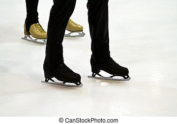 Feet skater standing on the ice