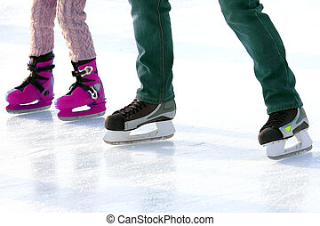 Feet skating on the ice rink. Sports and winter holidays