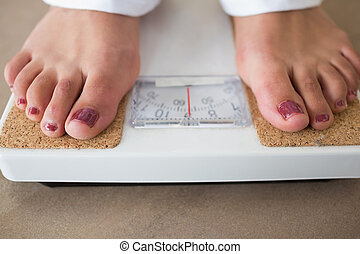Feet standing at the scale