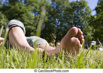 feet relaxing on grass (summer time)