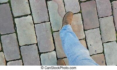 Feet walking on the tile POV