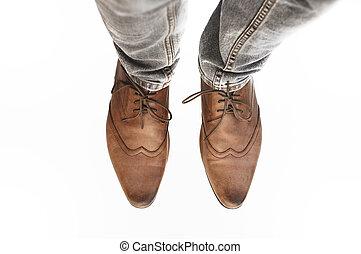 feet wearing vintage shoes