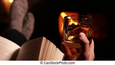 Feet&Fire - Man Reading Book And Drinking Glass Of Whisky ...