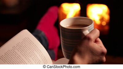 Feet&Fire - Woman Reading Book And Drinking Cup Of Tea ...