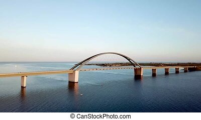 Fehmarn, Germany - May 11, 2019: Aerial drone view of the Fehmarn Bridge