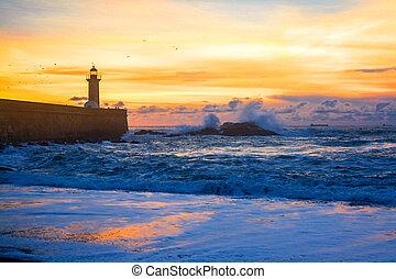 Felgueiras Lighthouse on shore of Atlantic ocean in Porto, Portugal at sunset
