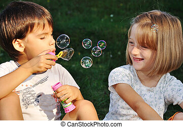 felice, carino, bambini giocando, con, bolle