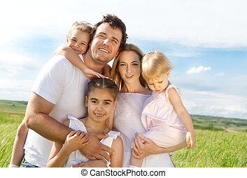 felice, giovane famiglia, con, tre bambini
