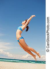 felice, saltare, donna, spiaggia