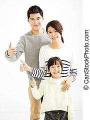 feliz, atractivo, familia joven, con, pulgar up